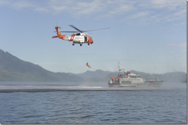KETCHIKAN, Alaska – A Coast Guard Station Ketchikan 47-foot Motor Life Boat crew patrols and a Coast Guard Air Station Sitka MH-60 Jayhawk Helicopter crew conduct helicopter hoist training south of Ketchikan July 11, 2011.  Station Ketchikan and Air Station Sitka often work together to ensure the safety and security of the residents and visitors to Southeast Alaska.  U.S. Coast Guard photo by Petty Officer 1st Class David Mosley