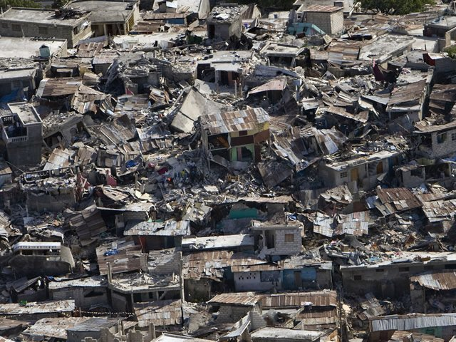 an image showing significant damage to buildings caused by the Haiti earthquake