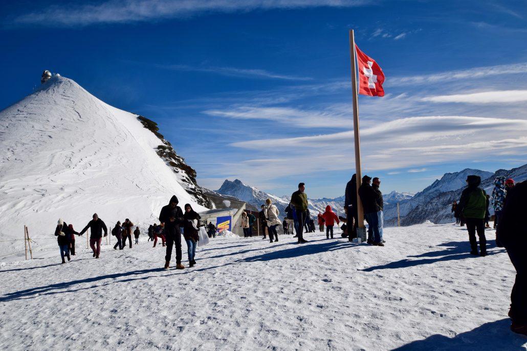 Tourists enjoying stunning views of the Alps at Junfrau, Switzerland.