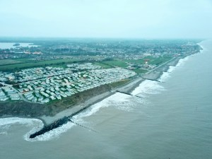 The view north along the Hornsea sea front. To the south is evidence of erosion to the south of the defences.