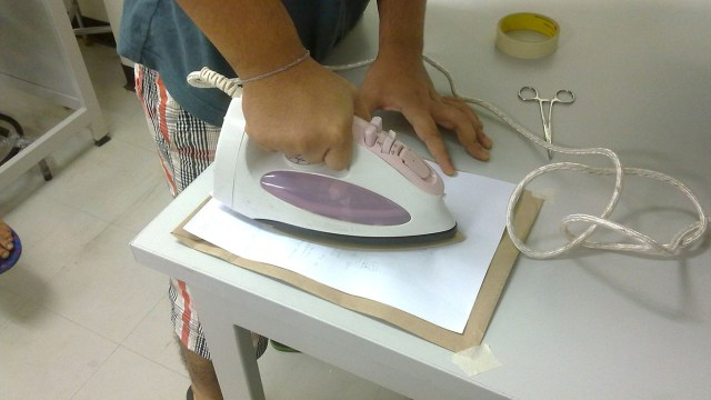 The ink from the paper will be transferred to the copper plate due to the heat