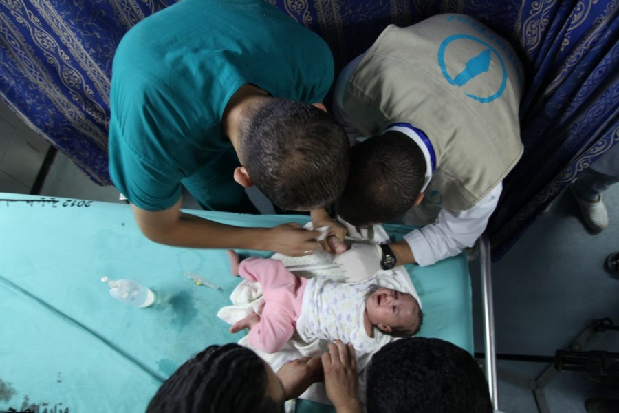 Interpal sponsored doctors take care of a Palestinian infant