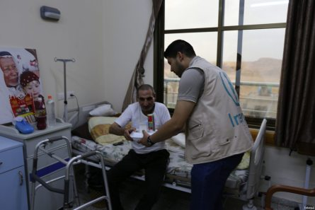 Interpal staff distribute medical aid to Palestinian patient