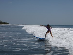 Zoe surfs