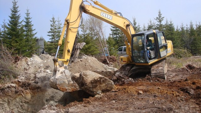 Dealing With a Big Rock While Digging