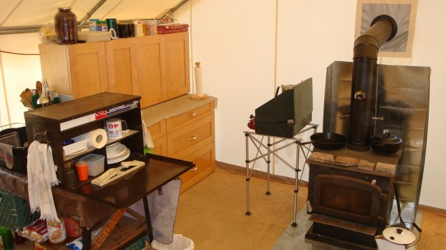 Wood Stove and Kitchen Area
