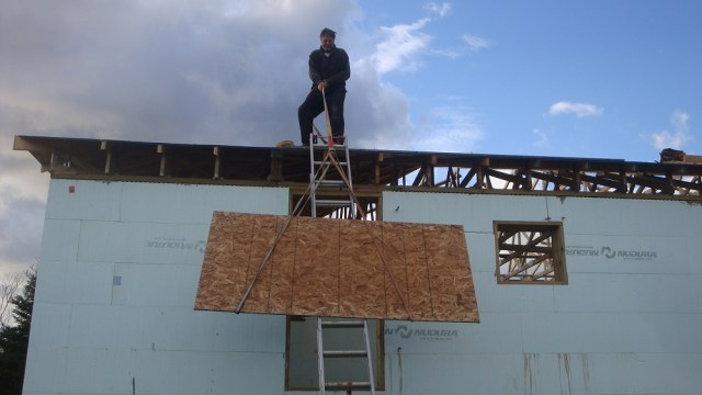 One Way to Haul Sheathing Up to the Roof