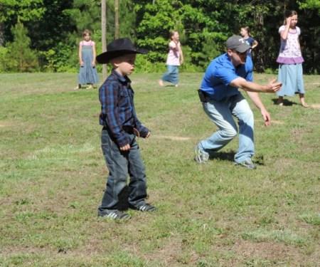 The cutest little cowboy kickball player... :)