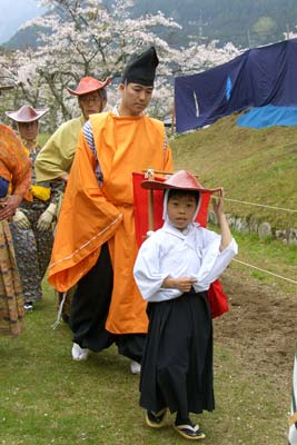 The youngest member of the Ogasawara School marches down the yabusame course as part of the opening procession of the ceremony.