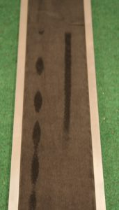 Standard putter on the left, Rife putter on the right