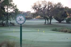 Putting green and clock near the first tee