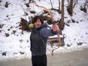 Hannah Yun with bow and arrow