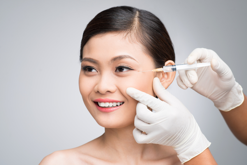 Happy woman at cosmetic surgeon