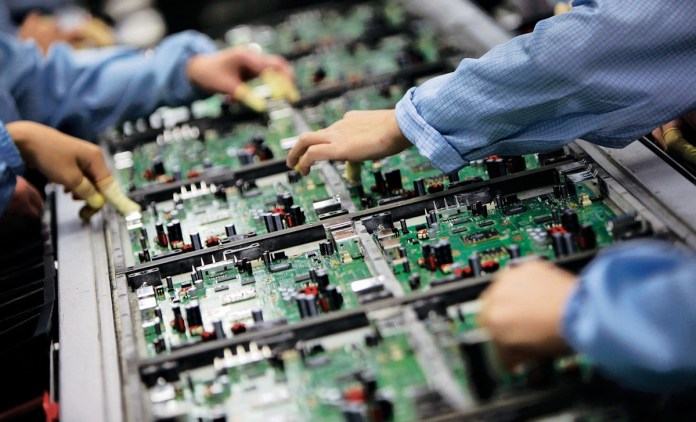 Electronics Manufacturing working on engineers