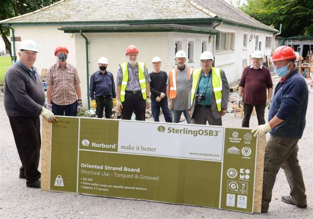 Members of the Inverness Men's Shed are delighted with the donation of materials from Norbord. Picture: Gary Anthony