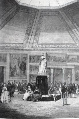 Estampa de Severini sobre diseño de J. Ruiz. Salón de la exposición de pinturas del Museo Nacional. 1858. Aparecida en el Museo Universal. La escultura de Isabel II responde al mismo modelo que la de la Plaza de Ópera en Madrid.
