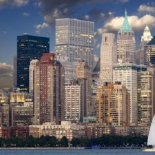 Yacht in harbor with city skyline - offshore investment account