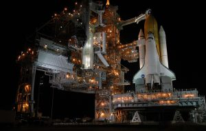 Space Shuttle Discovery at night before the launch of STS-114 mission - Financial Services