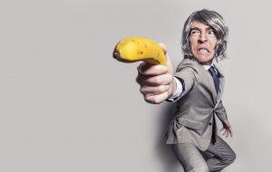 businessman-aiming-with-banana