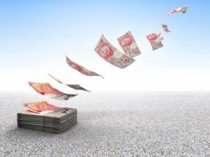 money blowing in wind