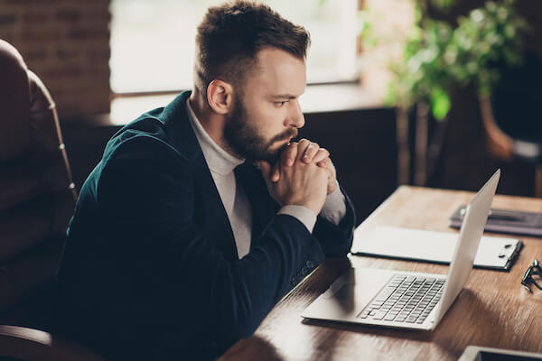 Man reading from his laptop