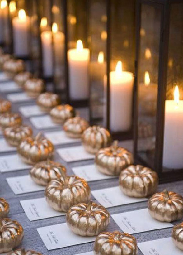 fall wedding gold pumpkins candles place cards escort cards reception seating