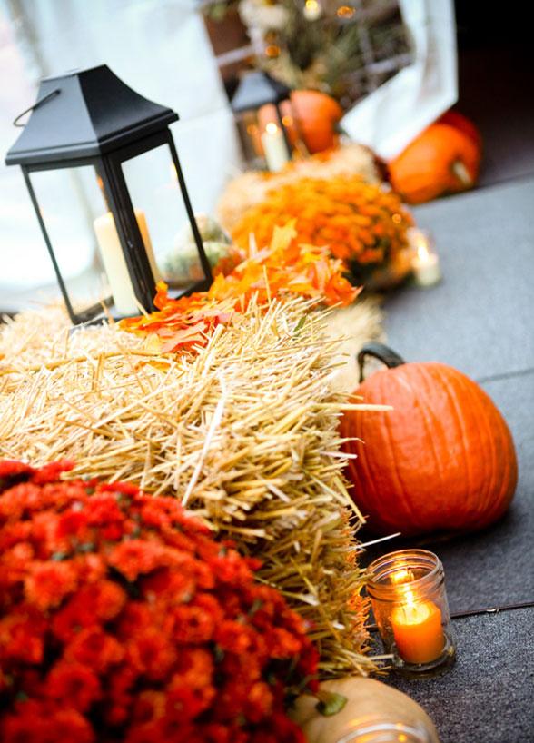 fall wedding decor pumpkins hay lanterns candles mason jar