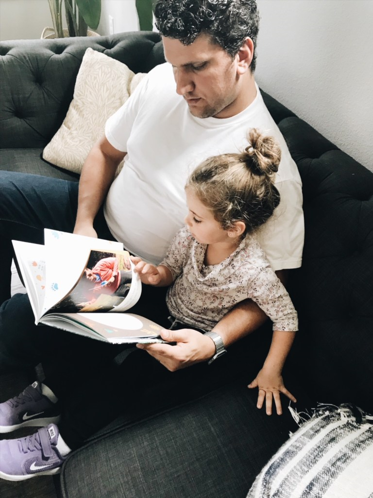 dad and daughter reading luhvee book