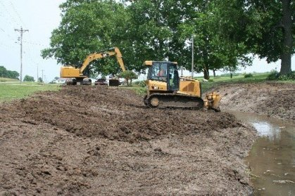 bulldozer beeing used to construct two-stage ditch