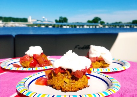 Homemade gluten free biscuits are topped with sweet roasted strawberries and rhubarb for a delicious summer treat!