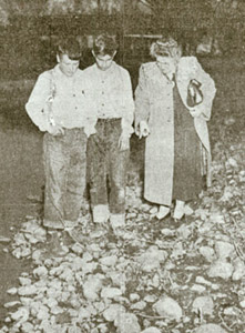 Boyd Larson and Cole Foster showing Boyd's mother where they found Chavis's gun (courtesy Ames Historical Society).