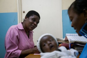 Community Health Workers Working with HIV-infected Mothers, photo credit USAID
