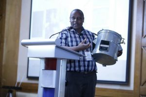 Kenyan innovator Kenneth Ndua showcases his energy-saving charcoal cooker that also purifies water, helping fight waterborne diseases. Photo Courtesy: African Academy of Sciences