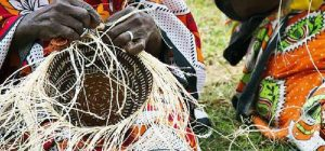 Women making Kiondo, a traditional Kenyan basket whose patent remains mystery.