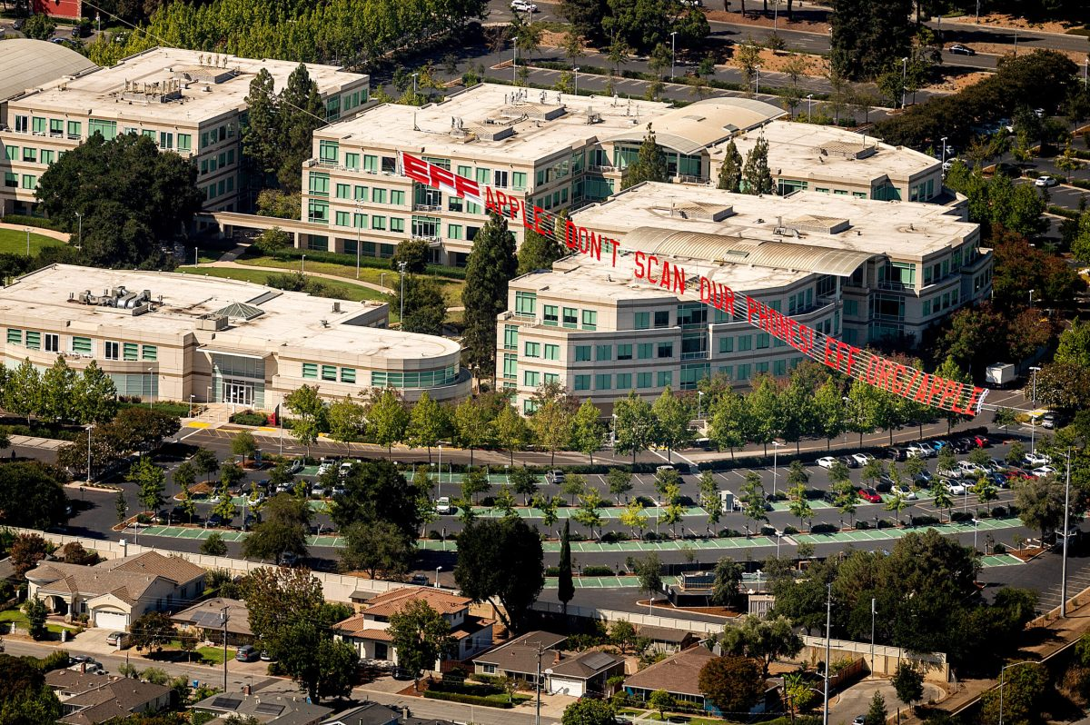 An NGO challenges Apple with a giant banner in front of its premises