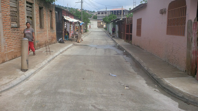 Paved streets instead of dusty or muddy dirt paths are one result of an integral programme for improving life in poor neighbourhoods on the steep hillsides of Tegucigalpa, which has involved active participation by the local communities. Credit: Thelma Mejía/IPS