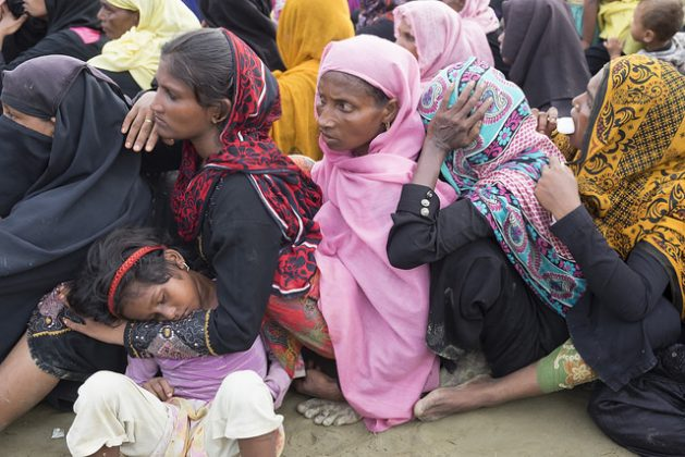 Women and children who escaped the brutal violence in Myanmar wait for aid at a camp in Bangladesh. Credit: Parvez Ahmad Faysal/IPS