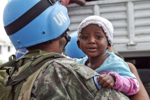 A UN peacekeeper holds a child as her mother is helped down from a relocation truck in Port-au-Prince, Haiti. Credit: UN Photo/Logan Abassi. The Oxfam scandal is an unfortunate blight. Organisations in similar circumstances must be transparent about how they punish culprits and what remedial and preventive actions they have taken. Justice must be unrelenting and exemplary, in pursuit of individuals who commit such acts, regardless of their rank or station. The guilty must go to jail in the country they commit such an offence.