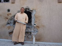 Khaled Abdullah next to the hole in the wall of his home in Bani Walid, the last stronghold of the Gaddafi regime.  / Credit:Karlos Zurutuza/IPS
