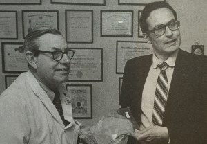 Dr. John Burke and Dr. Ioannis Yannas Holding their invention, Regenerated Skin, Patent 4,418,691
