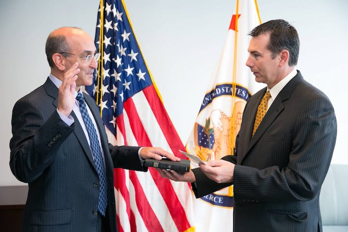 Drew Hirshfeld (left) being sworn in as new Commissioner for Patents earlier today by USPTO Deputy Director Russ Slifer.