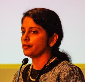 Abha Divine speaking at the 2014 IP Dealmakers Forum.