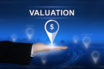IP market, financing - Financial valuation button with business hand on blurred background