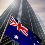 Australia national flag against low angle view of skyscraper