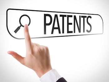 Hand searching online on white background with text: patents