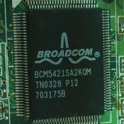 """Broadcom BCM5421SA2KQM"" by Solomon203. Licensed under CC BY-SA 3.0."