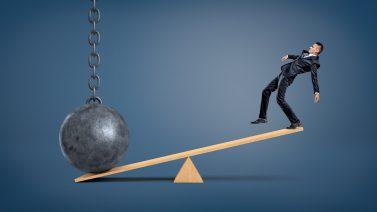 https://depositphotos.com/155031760/stock-photo-an-unbalanced-businessman-standing-on.htmlhttps://depositphotos.com/155031760/stock-photo-an-unbalanced-businessman-standing-on.html