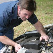 https://depositphotos.com/6628628/stock-photo-auto-mechanic-checks-engine.html