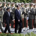 The president of the Presidium of North Korea's Supreme People's Assembly Kim Yong-nam, reviews an honor guard alongside Iranian President Mahmoud Ahmadinejad, during an official welcoming ceremony in Tehran, Iran, Saturday, Sept. 1, 2012. (Photo Credit: AP)