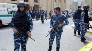Kuwaiti security forces gather outside the Shiite Al-Imam al-Sadeq mosque after it was targeted by a suicide bombing during Friday prayers on June 26, 2015, in Kuwait City. The Islamic State group-affiliated group in Saudi Arabia, calling itself Najd Province, said militant Abu Suleiman al-Muwahhid carried out the attack, which it claimed was spreading Shiite teachings among Sunni Muslims. AFP PHOTO / STR        (Photo credit should read STR/AFP/Getty Images)